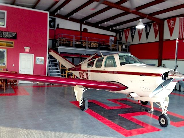 Small Plane On A Racedeck Floor